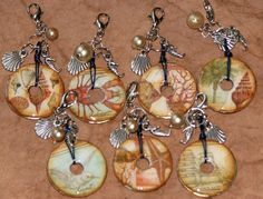 Pendants using washers, paper, archival ink, Glossy Accents, and charms