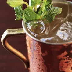 Kentucky Mule 2 oz Woodford Reserve Bourbon .5 oz lime juice Ginger beer