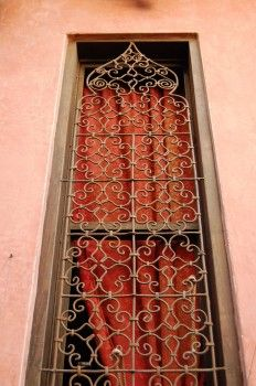 moorish style iron bars  pretty, light ironwork, but also for the color. not ugly grey like ours