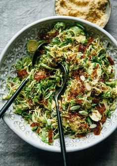 "Citrus Brussels Sprouts Slaw with Crispy Rice Paper ""Bacon"" Bits & Almond ""Parm"" 