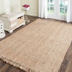 Add a rustic look to your home or office decor with this jute rug. Hand made from high quality natural jute, this beautiful rug will enhance any space. Primary materials: Jute Latex: No Pile height: 0 Natural Fiber Rugs, Natural Area Rugs, Natural Rug, Natural Texture, Natural Brown, Jute Rug, Woven Rug, Sisal Rugs, Braided Area Rugs