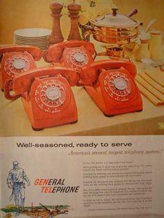 Big bright orange dial phone. We had this exact phone growing up.
