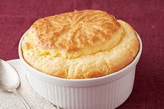 Soufflé gets a bad rap for being a hard-to-make dish. We hope to change that with this easy version made with Parmesan, cream cheese and sharp cheddar.
