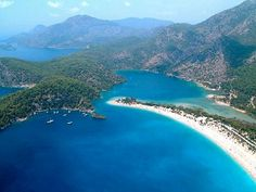 Oludeniz Beach-Blue Lagoon, Oludeniz - This stunning beach is a beautiful inland bay which stretches behind the cape. Here you can enjoy calm, crystal clear waters, perfect for children swimming and enjoy a variety of water sports.