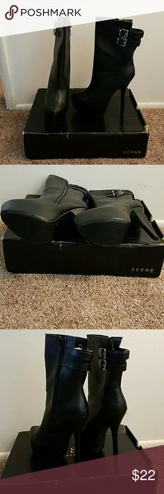 Shoe dazzle women's boots Women's black boots. Extremely sexy with a sleek look and high heel. Heel height is 6 inches with a pump height of about 2 inches. Cute silver buckle detailing. Brand new! The box is a little worn but heels are in brand new condition. Shoe Dazzle Shoes Heeled Boots