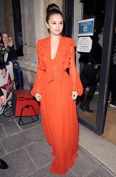 Selena Gomez is gorgeous in a redGiambattista Valli dress.