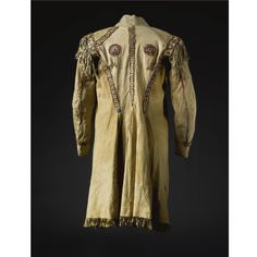 A CREE QUILLED HIDE COAT composed of finely tanned hide, porcupine quills, cotton thread and sinew.   Length with fringe 42 in.