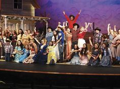 "The cast of ""Oklahoma!"" pauses for a big finish after singing the musical's namesake theme song about the territory."