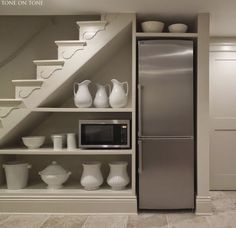 This basement bonus-room redo features a sleek, monochromatic palette and smart use of under-the-stair storage.