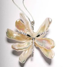 A pendant with a difference. A biwi pearl pendant with cubic zirconia forming a flower design. Set in 925 silver, complete with chain.    Price: £105.00 inc VAT