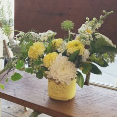 Sunny yellow garden style vase arrangement by Blossom & Vine Floral Co.
