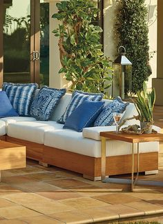 The beauty of the Tres Chic Modular Deep Seating Collection by Tommy Bahama lies not only in its remarkable design, but also in the blending of natural teak with brushed stainless steel. | Frontgate: Live Beautifully Outdoors