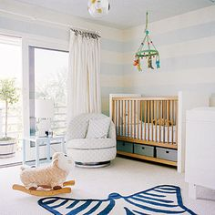 Any infant is sure to sleep soundly in a sea-inspired nursery swathed in the colors of the ocean. Try a bold piece, such as this...