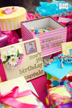 A baby girl time capsule to be opened on her 18th birthday.  See more first girl birthday party ideas at www.one-stop-party-ideas.com