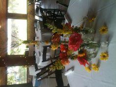 Table arrangements by Exquisite Petals