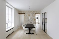 Dining Room in Paris with Exposed Stone Wall, 12 Favorite French Dining Rooms