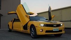 This hot yellow Chevy Camaro with black racing stripes is none other than the one and only Bumblebee! Skilled scout of the Autobot army with a spark the size of Cybertron itself. I mean, who can resist those baby blue optics and adorable warbling tones and whistles?