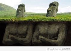 down below Easter Island heads.  They're digging and finding the heads have bodies. this photo idea would be so fun if even one were like this!