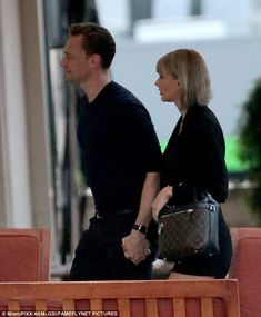 Getting closer: Taylor Swift and Tom Hiddleston took their fledgling relationship to a new level on Thursday