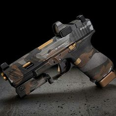 """The battle born glock with copperhead camo. An awesome gun with a lethal punch. Double tap the image to share the love. Visit Gun Carrier TODAY for more gun facts and news by clicking the Repost from Photo by """" Weapons Guns, Guns And Ammo, Pistola Airsoft, Gun Art, Custom Guns, Custom Glock, Shooting Guns, Military Guns, Cool Guns"""