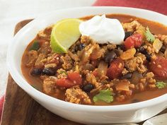 Turkey and Black Bean Chili - Spicy skillet dinner ready in 25 minutes! Enjoy this hearty soup made using turkey, tomatoes, Progresso® black beans and chicken broth.