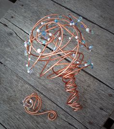 Metal Wedding Bouquet--a Steampunk Arrangement--upcycled copper with pearls & crystals.  via Etsy.   Definately something different