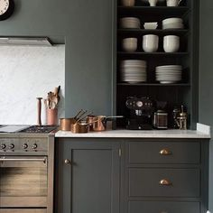 "I love a good white kitchen, but this one from DeVol Kitchens in the UK was a big inspiration for my new kitchen. I love the simplicity and the color. So cool, so moody. The clean lines work with my modern house, but the shaker style and brass accents check the ""antique"" box on the must-have list.  Here's hoping it looks as good in real life as it does in my head!"
