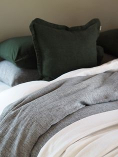 Slide under the comfortable and warm linen covers on a Christmas night. The linen bedding with pine green accents and and a soft, chunky throw create a cosy Christmas atmosphere. Find more home decor at Balmuir.