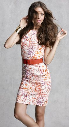 Cast in a bright, feminine palette, this color-dabbed style boasts paneled seaming details for a perfectly fitted look.