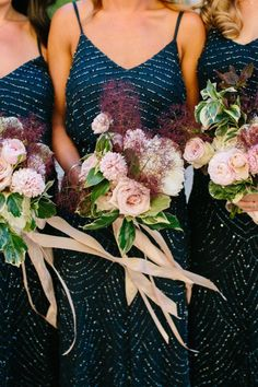 The best way to make a bride stand out from her bridal party is to dress the bridesmaids in a dark contrasting color. Like navy, maybe? This wedding had the prettiest navy color palette - the bridesmaids wore Art Deco inpired navy sequined bridesmaid dresses and carried blush wedding bouquets with maroon accents, greenery and blush roses tied with blush ribbon. Stunning for a modern wedding! | 11 Elegant Navy Wedding Ideas