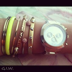 this is my style. two toned watch, neon, spike and crystal bracelets