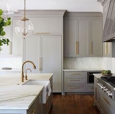 Love these cabinets. Love the pendant. And love the warmth of the counters.