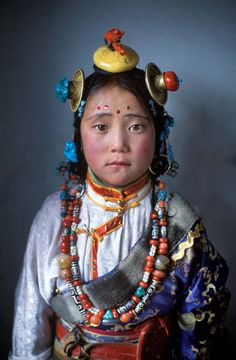 Tibetan nomad girl in Degang Valley, Kham, eastern Tibet. Alison Wright. For more ethnic fashion inspirations and tribal style visit www.wandering-threads.com