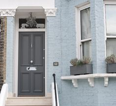 Love the colour of this house! The blue and grey combo is gorgeous!