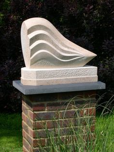 Ancaster Weatherbed Limestone #sculpture by #sculptor Jason Mulligan titled: 'From the Ocean Floor (Carved abstract Seawave statue)'. #JasonMulligan