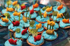 Goldfish ocean theme beach party idea - I'm not sure how many kids will EAT the broccoli and ?scallions? and not just throw them out, but it's cute.
