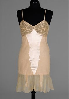 Vintage corselette or torsolette. Bra and longline girdle in one. This one has a sort of attached slip over it. Source: the MET museum.
