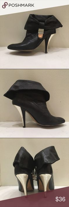 """STEVE MADDEN BLACK BOOTIE W/ SILVER BUCKLE. SIZE 7 BLACK LEATHER FOLD DOWN BOOTIE. WITH SILVER BUCKLE AND METAL STILETTO 3.5"""" HEEL. PREVIOUSLY OWNED WITH A SLIGHT CHIP ON VERY BOTTOM OF STILETTO HEEL. PLSE SEE PHOTO. Steve Madden Shoes Ankle Boots & Booties"""