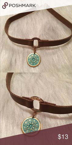 Brown suede chocker with brass pendent This choker is a light brown suede with a gold circle with a brass compass seafoam color pendant , it's 12 inches with a 4 inch extender handmade never been worn kathy netto design Jewelry Necklaces