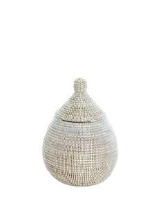 Store your items in this uniquely shaped basket.Weaved from a local grass and long strips of plastic ...