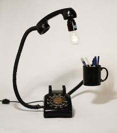 The Art Of Up-Cycling: Diy Lamp -Funky Lamps.  Repurposed Phone. Just to prove any house hold item can be given new life.  Film Biz Recycling is a non profit organization which creates jobs and helps prevent polution by recycling goods to practical, beautiful junctional pieces which appeal to young and old.