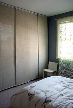 Wardrobe Ideas for Closetless Homes Good idea!  A wall of clothes, with sliding panels in front.