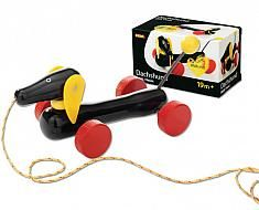 The dachshund dog pull toy from BRIO is a classic pull-along wooden toy. With unique wheels and moving tail, head and hears, this wooden pull along toy is black with red textured wheels that offer great traction.