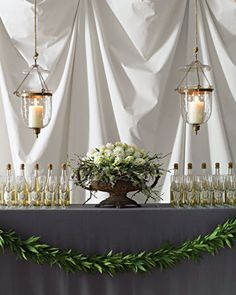 Love this look! Garland on bar and urn filled with hyacinths and lichen.
