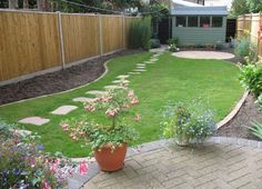 Wonderful landscaping flow from the patio to the garden shed!