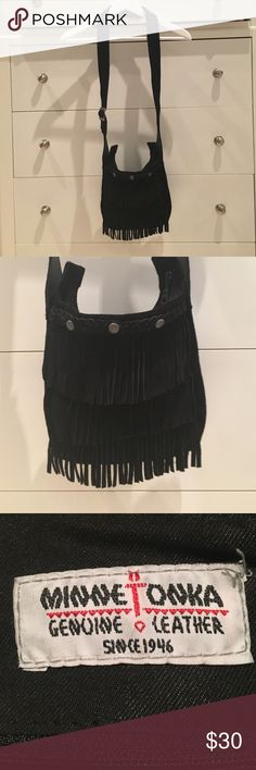 MINNETONKA FRINGE CROSSBODY BAG This Minnetonka handbag is a boho original. A simple suede pouch with three tiers of fringe, it has a look that's just as relevant today as it was back in the day. PRE-LOVED. Minnetonka Bags Crossbody Bags