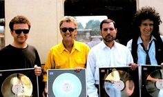 Four boys with Platinum albums