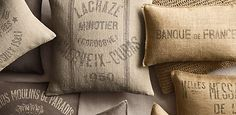 Restoration hardware is great, but you can do this yourself, Find some old grain or rice sacks, a plain pillow or stuffing, and sew it. Its simple, easy and cheap.