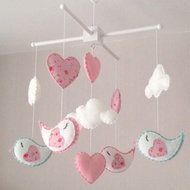 Clouds, birds and pink hearts baby crib mobile. An ideal gift for a new baby's nursery or for room decor in an older child's bedroom. This mobile consists of three white clouds, four birds, two pink and two mint green, each with beautiful heart shaped ...