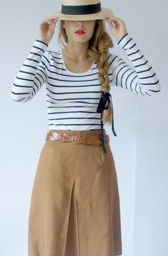 Stripes with khaki skirt (could pair with shorts or skinny pants as well). Hat and a simple braid. Red lip
